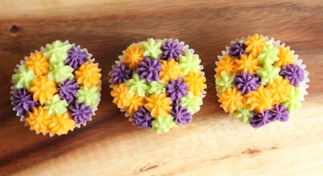 green purple orange cupcakes